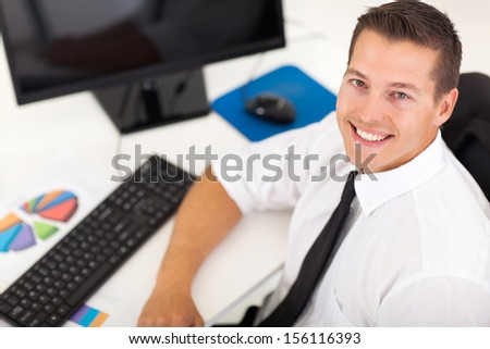 overhead view of young businessman sitting in office - stock photo