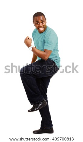 Overjoyed celebrating African American man on white background  - stock photo