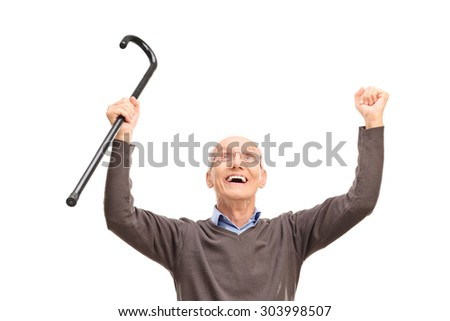 Overjoyed senior holding a black cane an looking up isolated on white background - stock photo