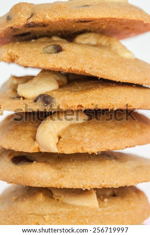 overlap of cookies cashew nut and chocolate chip on white background - stock photo