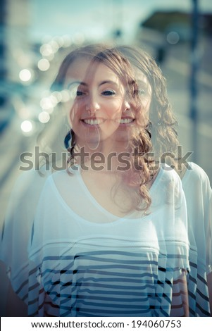 overlap young beautiful brunette woman in the city - stock photo