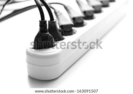 Overloaded power board, isolated on white - stock photo