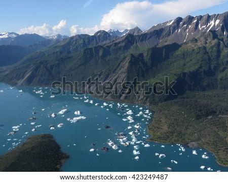Overlooking glacier chunks in the waters around Resurrection Bay, Alaska - stock photo