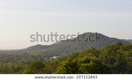 Overlooking lush mountain slopes, which stretch down to the rain forest and home alone. - stock photo