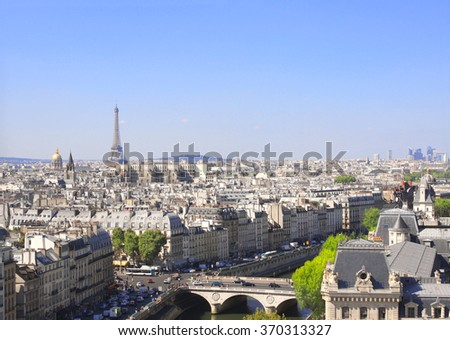 Overlooking Paris up on Notre Dame de Paris and river Seine, France - stock photo