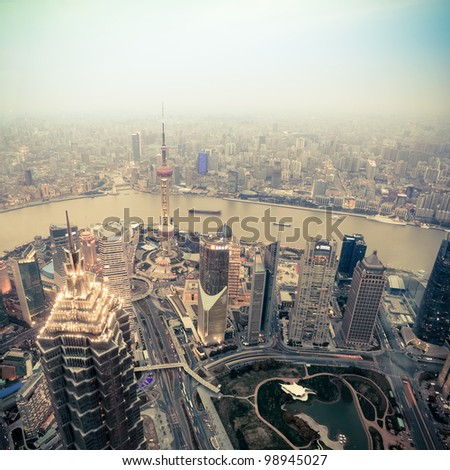 overlooking shanghai at dusk from world financial center - stock photo