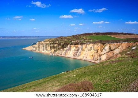 Overlooking the beach and colourful sandy cliffs at Alum Bay on the Isle of Wight England UK Europe - stock photo