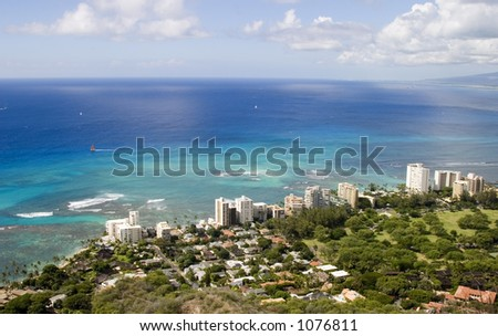 Overlooking the beautiful South Oahu coastline from the top of Diamond Head. - stock photo