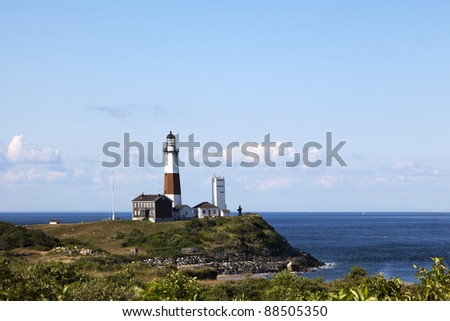 Overlooking the Montauk Point Lighthouse from the cliffs of Camp Hero. Montauk Point, Long Island, New York. - stock photo