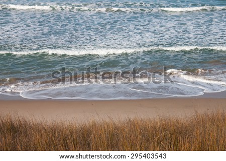 overlooking the Pacific Ocean from a grassy hill on the East Coast of New Zealand's North Island - stock photo