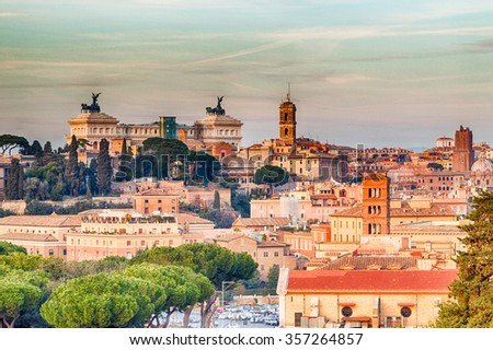 overlooking the rooftops of Rome, historic palaces, Catholic churches and old houses - stock photo