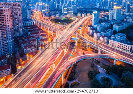 overpass closeup on city road junction at night in shanghai - stock photo