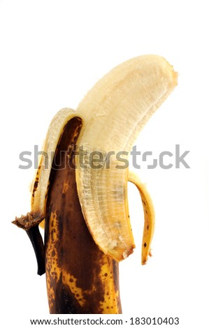 Overripe banana in front of a white background - stock photo