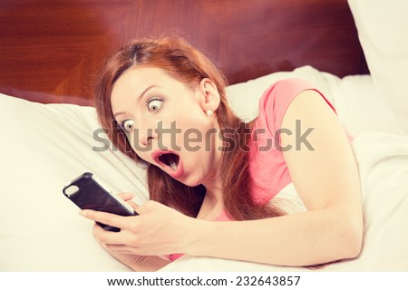 Oversleeping. Attractive young woman missed the ringing of the alarm clock and have overslept awakening and are late, reacting in horror at the time. Funny face expression, emotion, feeling, reaction - stock photo