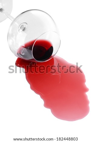 Overturned glass of wine isolated on white - stock photo