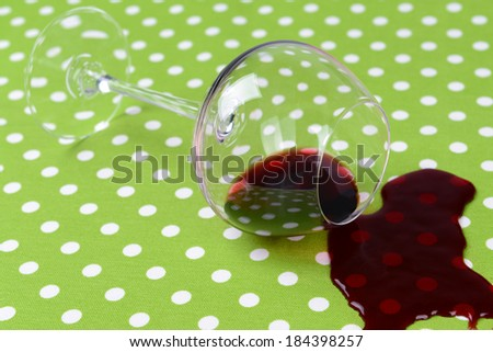 Overturned glass of wine on table close-up - stock photo