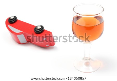 Overturned wooden toy car with glass of wine, car and alcohol, don't drink and drive concept. Isolated on white background - stock photo