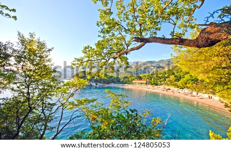 Overview from scenic beach and green mountains in the beautiful bay, Mediterranean sea (Italy), wide angle - stock photo