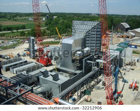 Overview of power plant under construction - stock photo