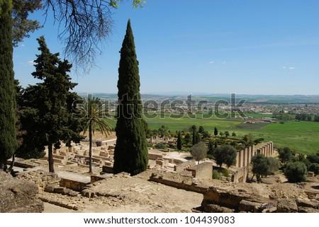 Overview of ruined town and surrounding countryside, Medina Azahara (Madinat al-Zahra), Near Cordoba, Cordoba Province, Andalusia, Spain, Western Europe. - stock photo