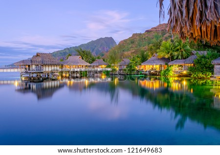 Overwater Bungalows at dusk, French Polynesia - stock photo
