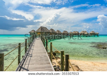 Overwater bungalows in Tikehau, Tahiti - stock photo