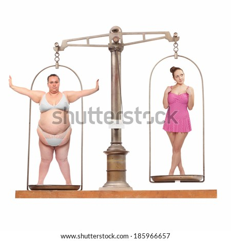 Overweight and slim. Balance scale with two young women. Weight loss concept. - stock photo