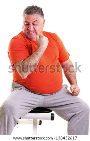 Overweight man showing his strength after doing exercises seated on a bench  isolated on white - stock photo