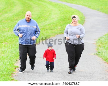 Overweight parents with her son running together. Weight loss concept. - stock photo