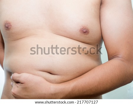 overweight problem of fat asian guy unwell shape diet issues - stock photo
