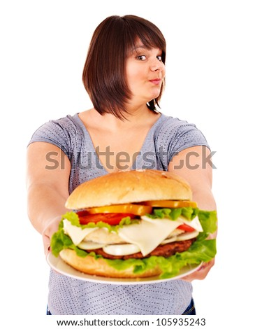 Overweight woman eating hamburger. Isolated. - stock photo