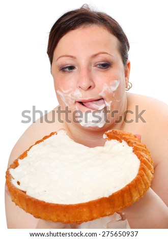 Overweight woman eating sweet cake with whipped cream. - stock photo