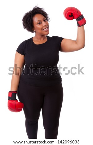 Overweight young black woman holding boxing gloves, isolated on white background - African people - stock photo