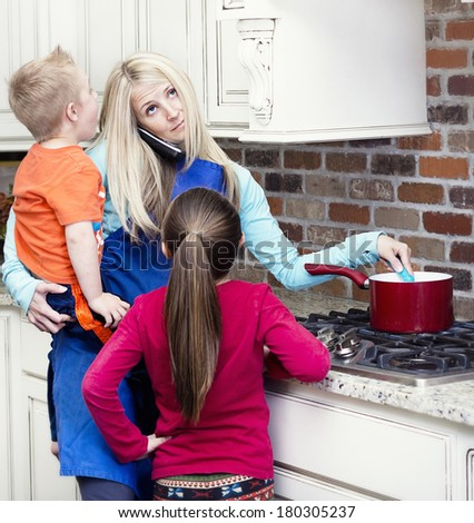 Overwhelmed and frustrated Mom in the kitchen - stock photo
