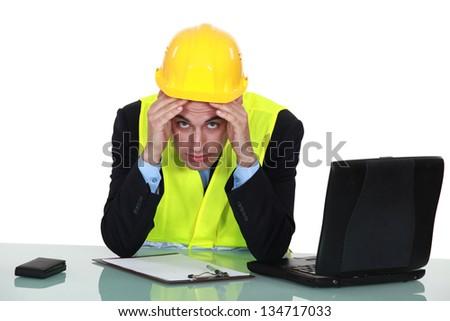 overwhelmed businessman - stock photo