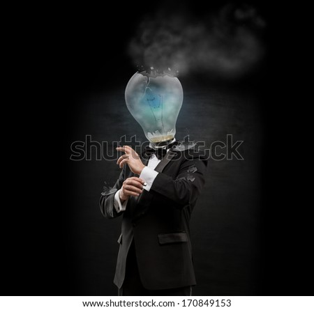 Overworked burnout business man standing headless with exploded bulb instead of his head. Strong stress concept - stock photo