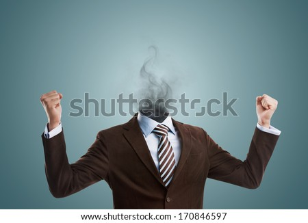 Overworked burnout business man standing headless with smoke instead of his head. Strong stress concept - stock photo