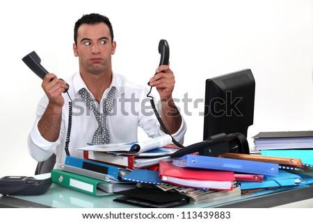 overworked businessman - stock photo