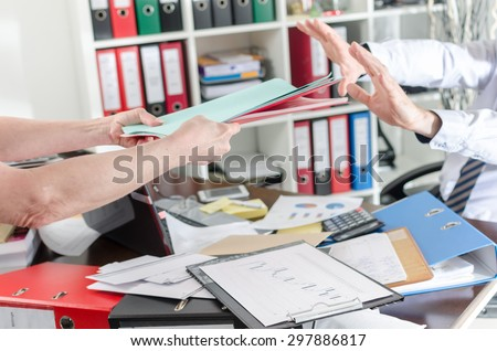 Overworked businessman refusing work - stock photo