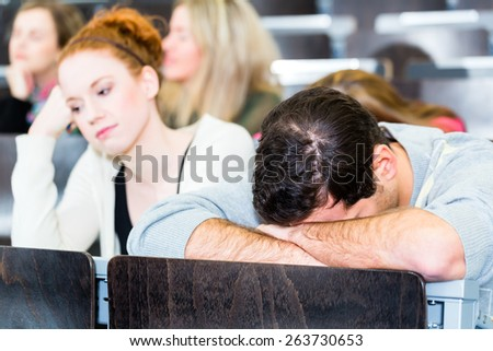 Overworked college students being tired - stock photo