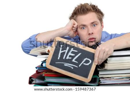 Overworked man - stock photo