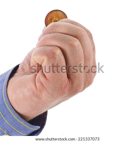 overworked man's hand holding a coin coins  isolated on white background - stock photo