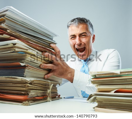 Overworked mature business man screaming in anger - stock photo