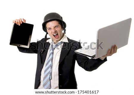 overworked, stressed and angry business man wearing a helmet screaming holding a tablet and laptop on a white background.  - stock photo