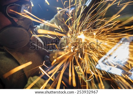 overwrites the master of welding seams angle grinder - stock photo