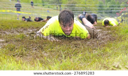 OVIEDO, SPAIN - MAY 9: Storm Race, an extreme obstacle course in May 9, 2015 in Oviedo, Spain. Runners crawled under barbed wire. - stock photo