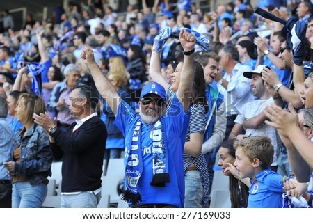 OVIEDO, SPAIN - MAY 10:  Supporters of Real Oviedo celebrate a goal during the football match between Real Oviedo and Somozas in the Carlos Tartiere stadium in May 10, 2015 in Oviedo, Spain. - stock photo