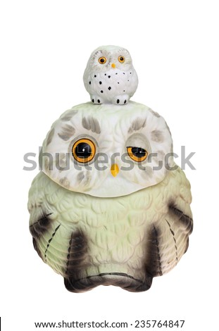 owl made of pottery on white background - stock photo