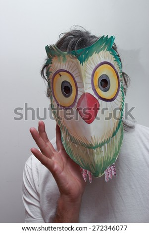 owl mask man - stock photo