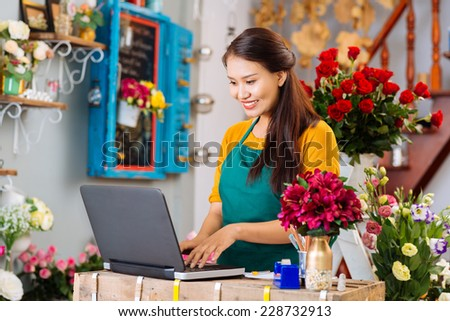 Owner of flower shop - stock photo